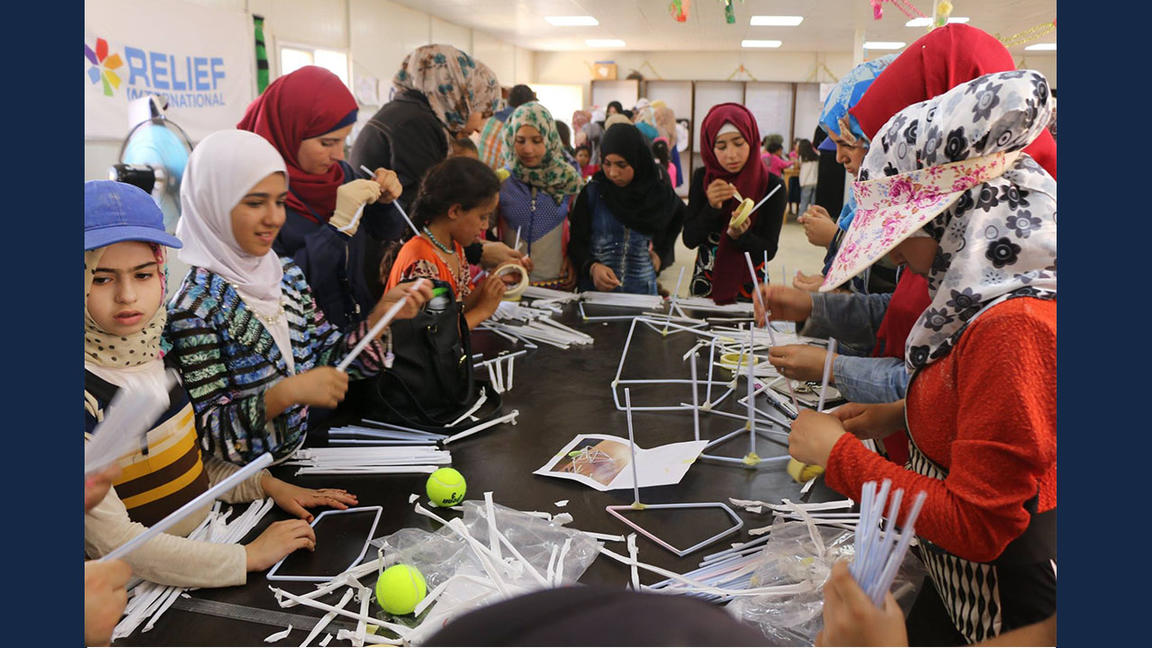 Syrian refugee children work on STEM project